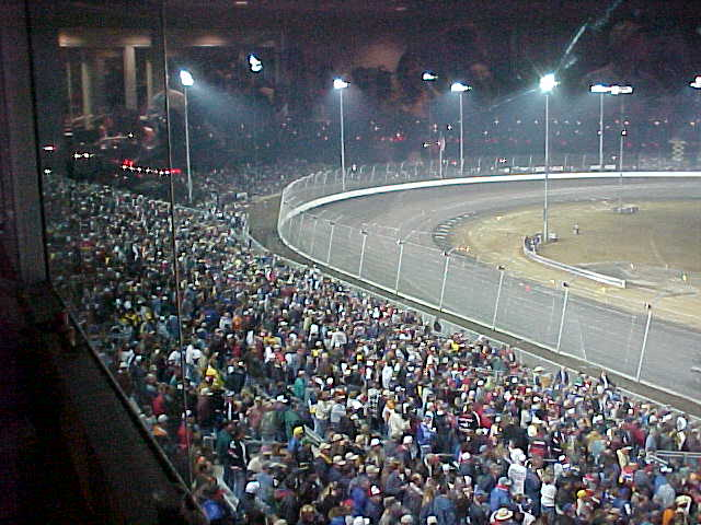 View of turn 4 and standing room only crowd at Texas Motor Speedway.